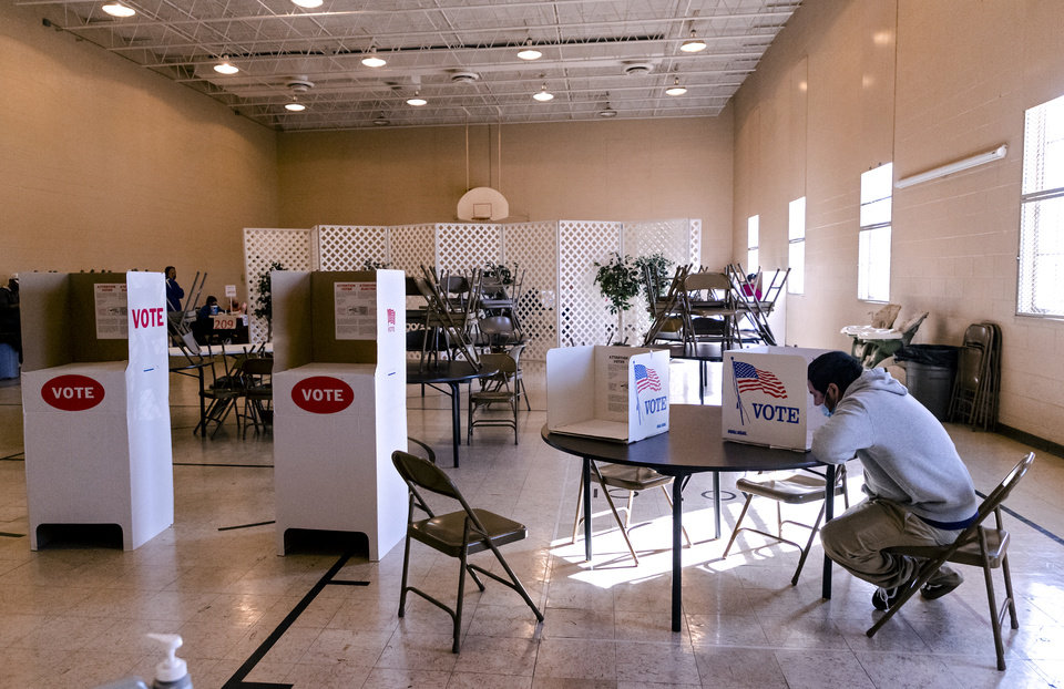 Photo - A voter fills out his ballot at the Mayridge Baptist Church in Oklahoma City, Okla. on Tuesday, Nov. 3, 2020. [Chris Landsberger/The Oklahoman]