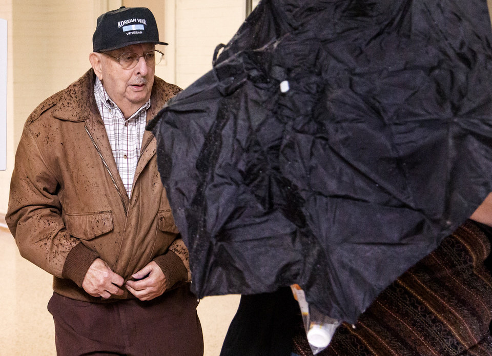 Photo - Arnold Cowen, the 86-year-old ex-teacher's aide accused of molesting multiple girls at Upper Elementary School in Perry, arrives at the Noble County Courthouse to accept a plea deal during a pre-trial conference in Perry, Okla. on Thursday, Feb. 22, 2018.  Photo by Chris Landsberger, The Oklahoman