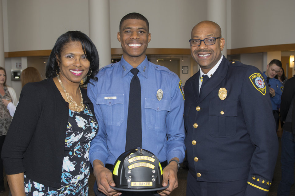 Photo -  Malcolm Baker is pictured here with his mom and dad, Davie L. and Jack Baker, at the Oklahoma City Fire Department recruit graduation. [Photo provided]