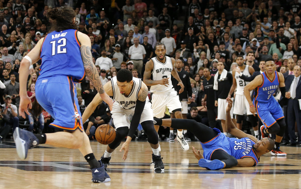 Photo - San Antonio's Danny Green (14) gathers the ball as Oklahoma City's Kevin Durant (35) falls down in the final seconds of Game 2 of the second-round series between the Oklahoma City Thunder and the San Antonio Spurs in the NBA playoffs at the AT&T Center in San Antonio, Monday, May 2, 2016. Oklahoma City won 98-97. Photo by Bryan Terry, The Oklahoman