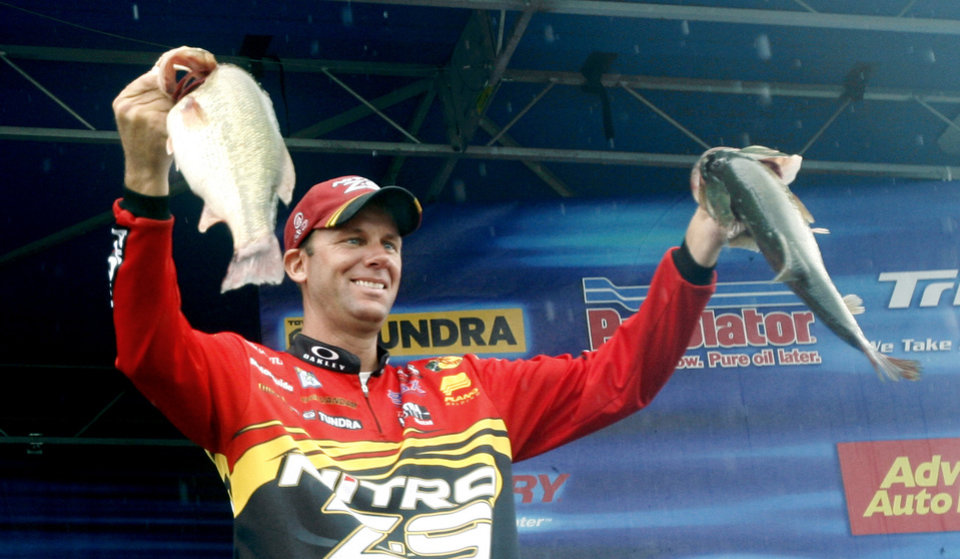 Photo -  BASS ELITE SERIES TOURNAMENT, PRO, PROFESSIONAL FISHING TOURNAMENT: Kevin VanDam holds up two of his bass during weigh-in concluding the final day of the Bassmaster Elite Series Sooner Run on Grand Lake O' the Cherokees in Grove, Okla., Friday, June 24, 2007. By Matt Strasen, The Oklahoman  ORG XMIT: KOD