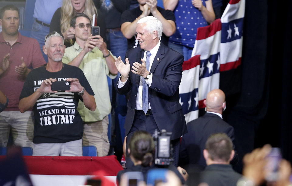 Photo - Vice President Mike Pence claps as he enters the arena during the President Donald Trump rally at the BOK Center in Tulsa, Okla., Saturday, June 20, 2020. [Sarah Phipps/The Oklahoman]