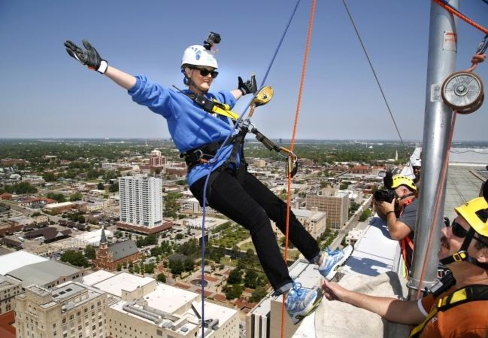 Photo -  In this 2015 photo, Kelly Dyer Fry, editor of The Oklahoman, prepares to rappel down the former SandRidge Energy Tower in downtown Oklahoma City to bring awareness and to raise funds for Shatterproof, an organization dedicated to ending the stigma of addiction. [Oklahoman archive photo]