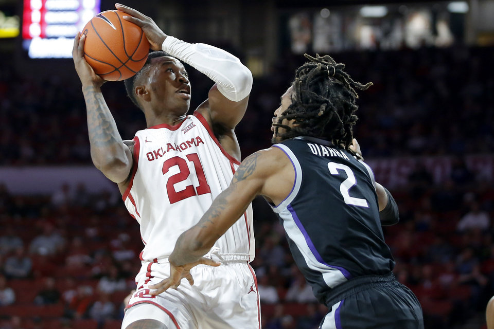 Photo - Oklahoma's Kristian Doolittle (21) tries to get around Kansas State's Cartier Diarra (2) during an NCAA college basketball game between the University of Oklahoma Sooners (OU) and the Kansas State Wildcats at Lloyd Noble Center in Norman, Okla., Saturday, Jan. 4, 2020. Oklahoma won 66-61. [Bryan Terry/The Oklahoman]