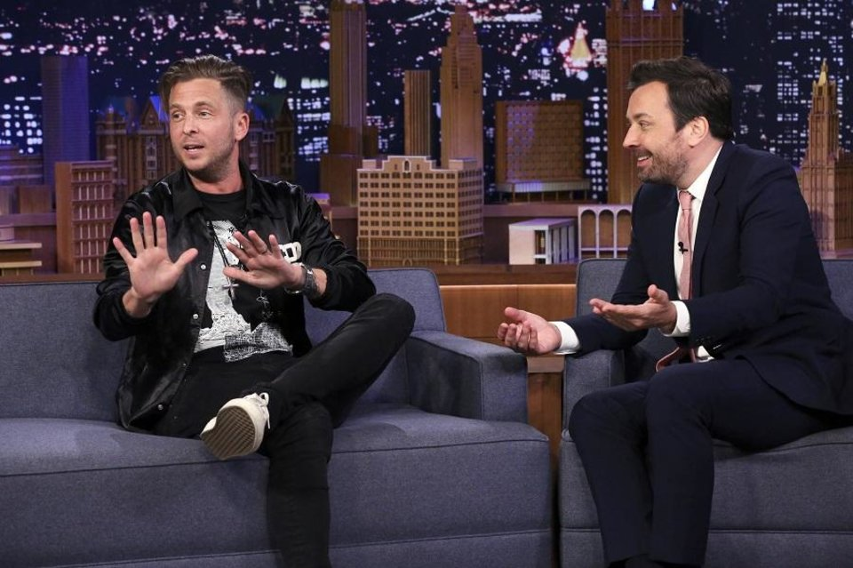 Photo - Singer-songwriter Ryan Tedder speaks during an interview with host Jimmy Fallon on