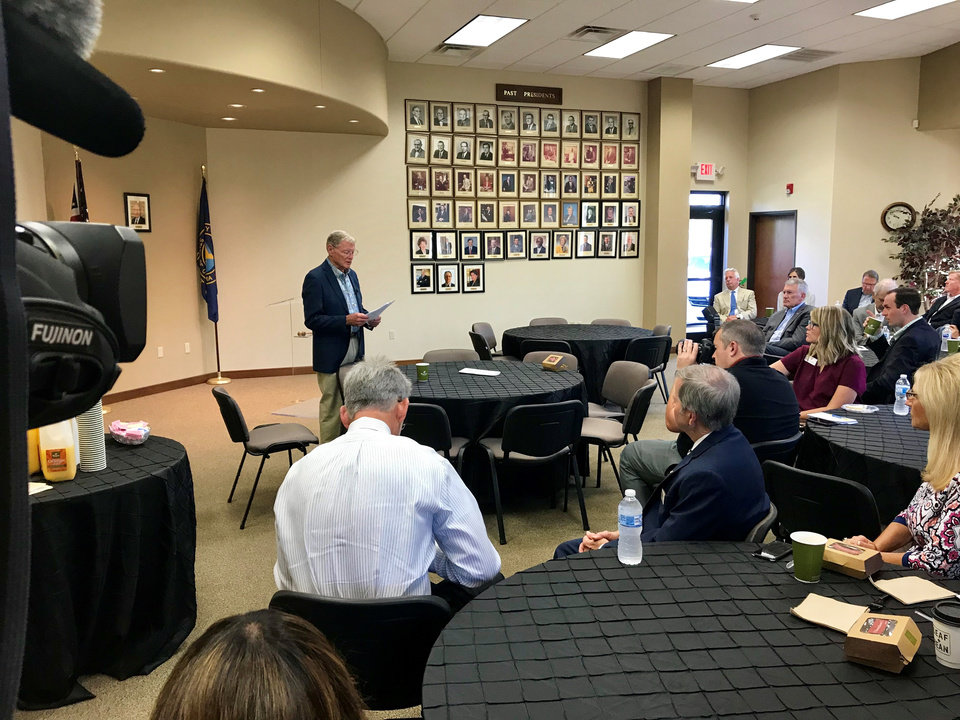 Photo -  U.S. Sen. Jim Inhofe, R-Tulsa, speaks to a small crowd at the Midwest City Chamber of Commerce on Thursday. [Photo by Justin Wingerter, The Oklahoman]