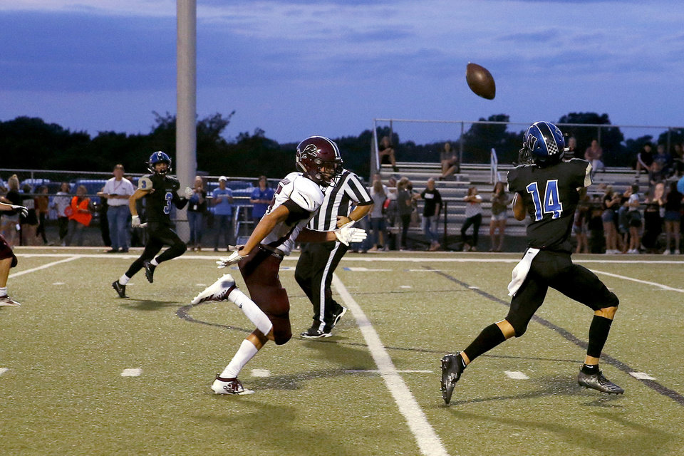 Photo - Newcastle's Teagun Jordan catches a pass against Blanchard on Sept. 19 in Newcastle. [Bryan Terry/The Oklahoman]