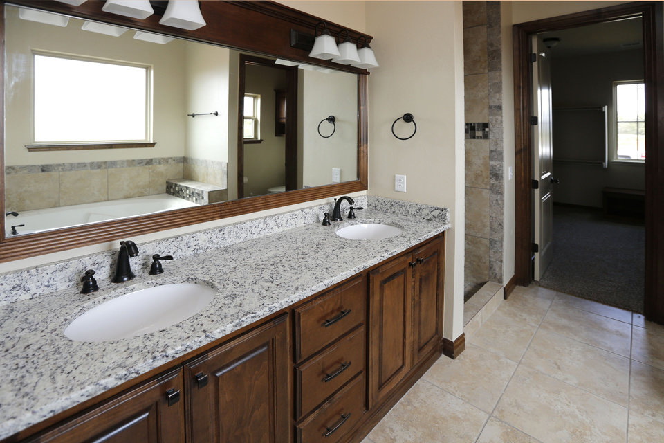 Trend The master bath in the House of Hope features a double sink vanity PHOTO BY PAUL HELLSTERN THE OKLAHOMAN