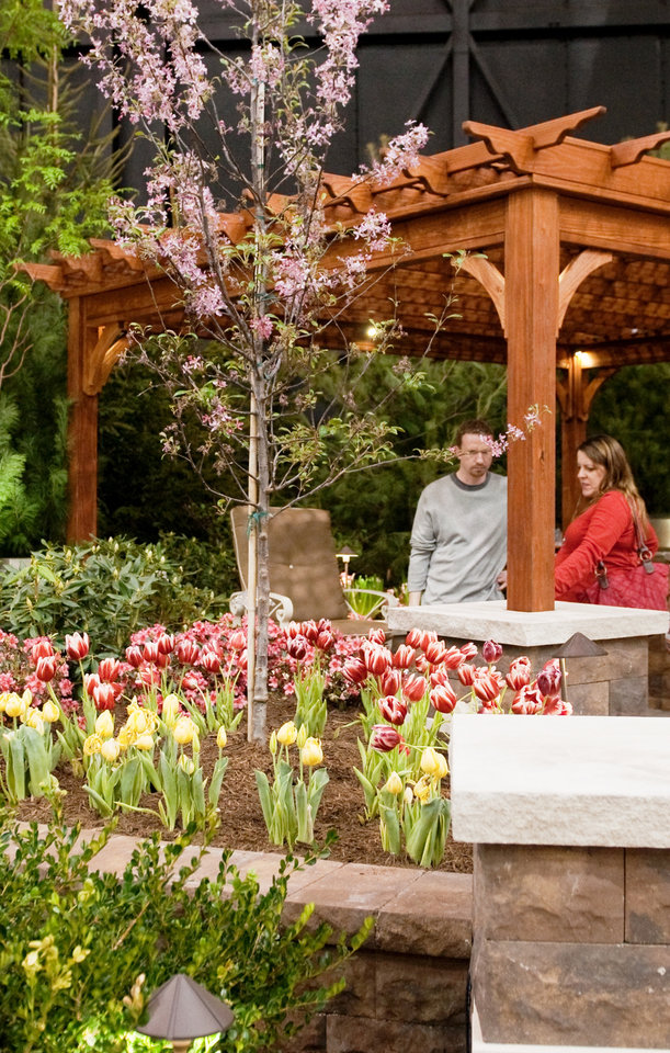Spectacular People look at a pergola at a previous OKC Home Outdoor Living Show