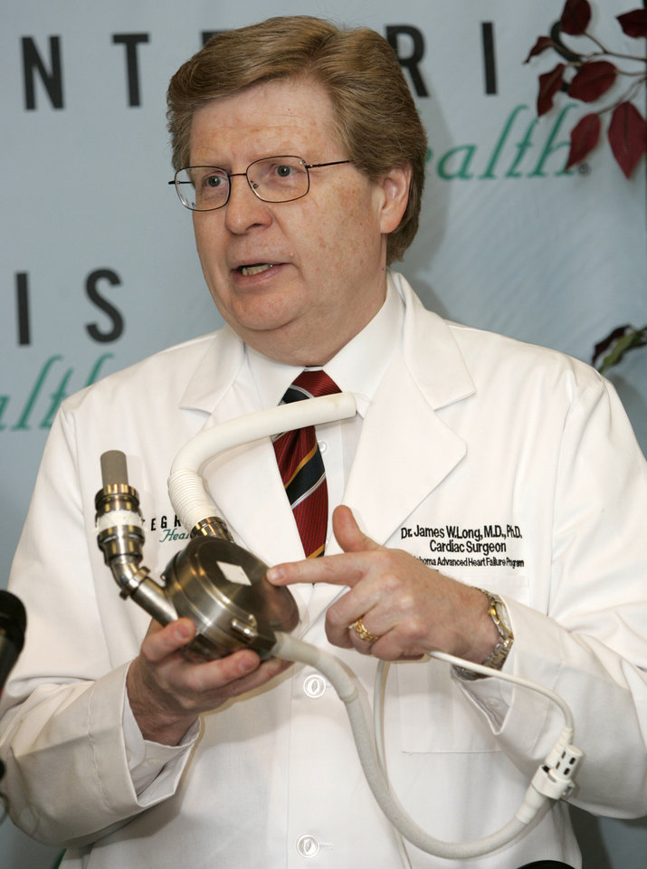 Photo - AUGUSTUS HARBERT: James Long, M.D., Ph.D., Cardiovascular Surgeon, Director Oklahoma Heart Failure Program at INTEGRIS Baptist Medical Center, explains the artificial heart pump he used to save the life of Augustus