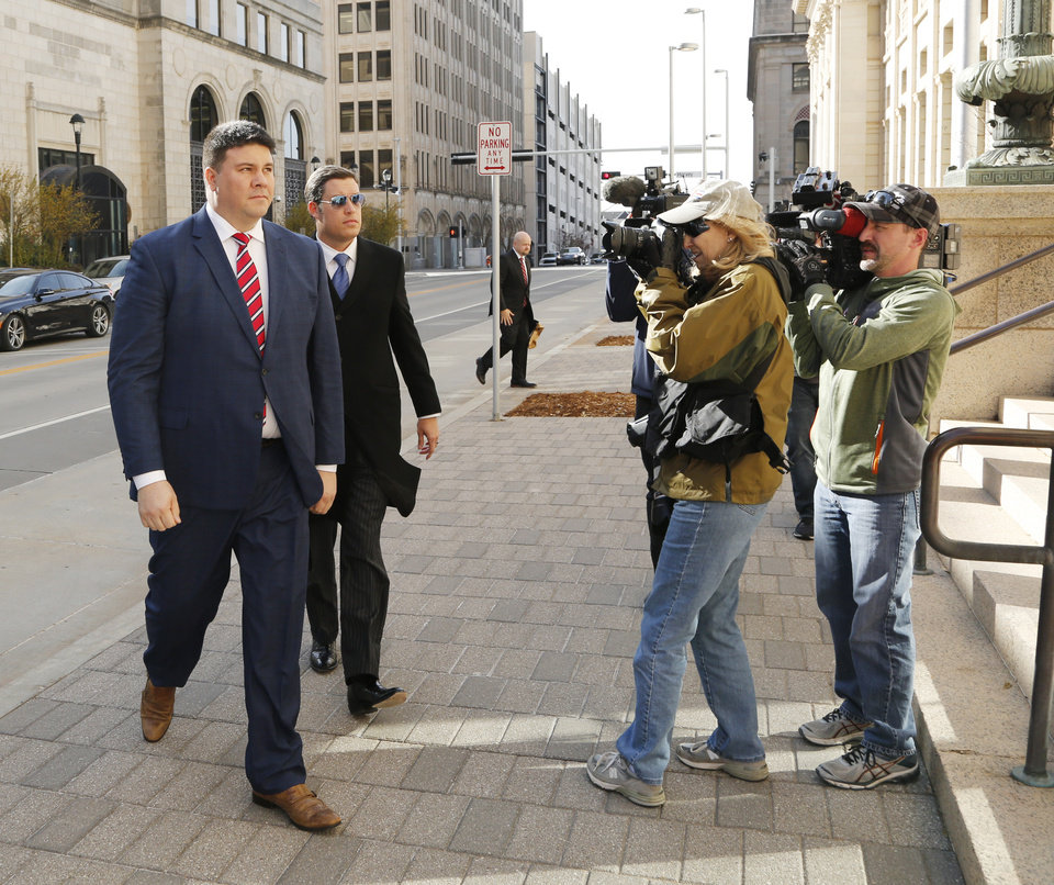 Photo -  Former Sen. Ralph Shortey, left, walks with defense attorney Ed Blau to the federal courthouse in Oklahoma City to plead guilty to child sex trafficking. [Photo by Doug Hoke, The Oklahoman]