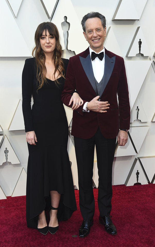 Photo -  Olivia Grant, left, and Richard E. Grant arrive at the Oscars on Sunday, Feb. 24, 2019, at the Dolby Theatre in Los Angeles. (Photo by Jordan Strauss/Invision/AP)