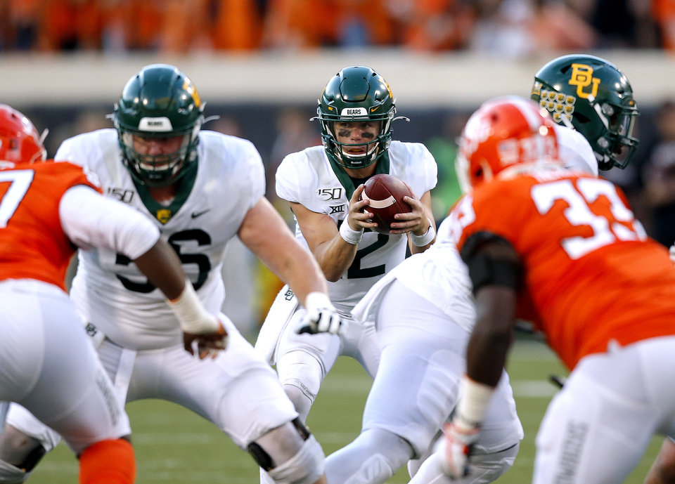 Photo - Baylor's Charlie Brewer (12) runs a play in the fourth quarter during the college football game between Oklahoma State University and Baylor at Boone Pickens Stadium in Stillwater, Okla., Saturday, Oct. 19, 2019. Baylor won 45-27. [Sarah Phipps/The Oklahoman]