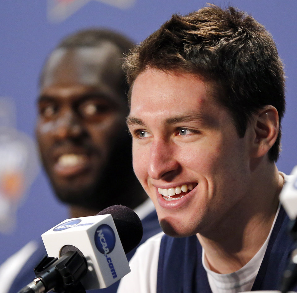 Photo - Villanova's Ryan Arcidiacono (15) speaks as Daniel Ochefu (23) looks on during a press conference on Final Four Friday before the national semifinal between the Oklahoma Sooners and the Villanova Wildcats in the NCAA Men's Basketball Championship at NRG Stadium in Houston, Friday, April 1, 2016. OU will play Villanova in the Final Four on Saturday. Photo by Nate Billings, The Oklahoman