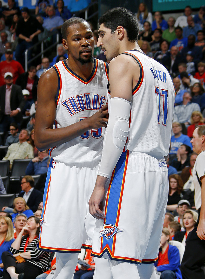 Photo - Oklahoma City's Kevin Durant (35) talks with Enes Kanter (11) during an NBA basketball game between the Oklahoma City Thunder and the Houston Rockets at Chesapeake Energy Arena in Oklahoma City, Friday, Jan. 29, 2016. Oklahoma City won 116-108. Photo by Bryan Terry, The Oklahoman