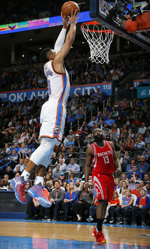 Photo - Oklahoma City's Russell Westbrook (0) goes to the basket as Houston's James Harden (13) watches during an NBA basketball game between the Oklahoma City Thunder and the Houston Rockets at Chesapeake Energy Arena in Oklahoma City, Friday, Jan. 29, 2016. Photo by Bryan Terry, The Oklahoman