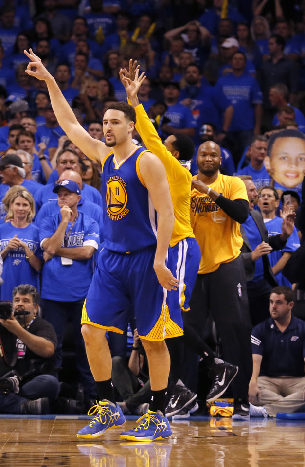 Photo - Golden State's Klay Thompson (11) celebrates a 3-point basket in the fourth quarter during Game 6 of the Western Conference finals in the NBA playoffs between the Oklahoma City Thunder and the Golden State Warriors at Chesapeake Energy Arena in Oklahoma City, Saturday, May 28, 2016. Photo by Sarah Phipps, The Oklahoman