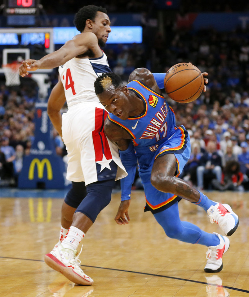 Photo - Oklahoma City's Dennis Schroder (17) drives past Washington's Ish Smith (14) in the second quarter during an NBA basketball game between the Oklahoma City Thunder and the Washington Wizards at Chesapeake Energy Arena in Oklahoma City, Friday, Oct. 25, 2019. [Nate Billings/The Oklahoman]