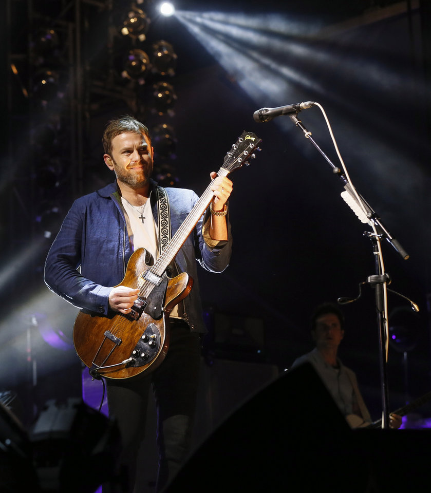 Photo - Caleb Followill and Kings of Leon perform during the grand opening of Scissortail Park in Oklahoma City, Friday, Sept. 27, 2019. [Nate Billings/The Oklahoman]