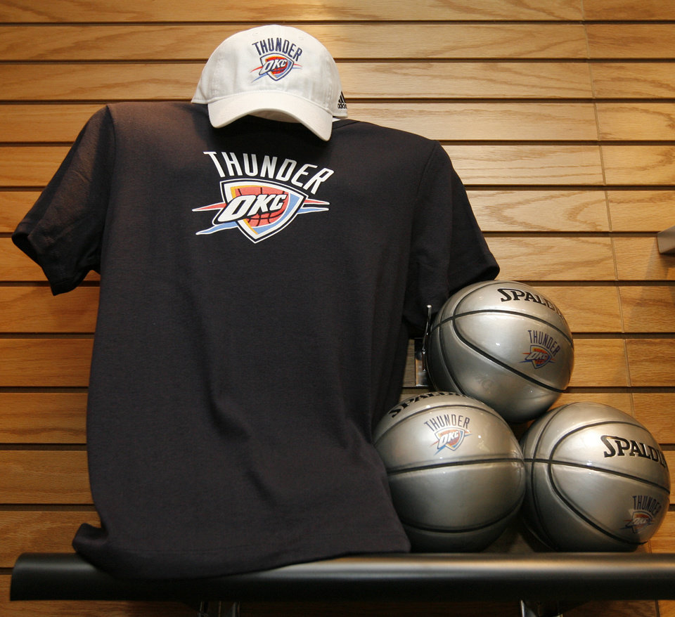 Photo - A display with a hatm, shirt and balls in the team store after the unveiling of the Oklahoma City Thunder NBA team name at Leadership Square in downtown Oklahoma City, Wednesday, September 3, 2008. NATE BILLINGS, THE OKLAHOMAN