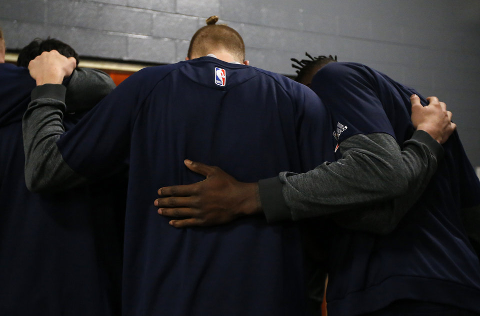 Photo - Oklahoma City huddles before Game 2 in the first round of the NBA playoffs between the Oklahoma City Thunder and the Houston Rockets in Houston, Texas,  Wednesday, April 19, 2017.  Photo by Sarah Phipps, The Oklahoman