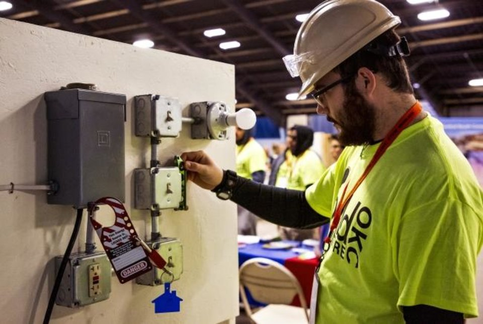 Photo -  Ryan Benner, with the Tulsa Job Corps, takes part in some electrical hands-on activities during the Build My Future OKC Construction Career Exploration Day at the Oklahoma Expo Hall in Oklahoma City in October. [Chris Landsberger/The Oklahoman]