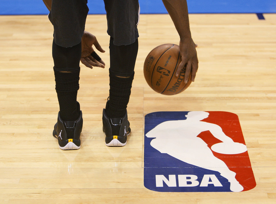 Photo - Miami's Dwyane Wade dribbles the ball during media and practice day for the NBA Finals between the Oklahoma City Thunder and the Miami Heat at the Chesapeake Energy Arena in Oklahoma City, Monday, June 11, 2012. Photo by Nate Billings, The Oklahoman