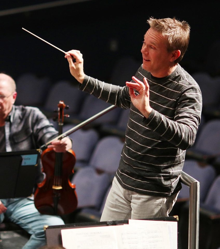 Photo - Alexander Mickelthwate leads the Oklahoma City Philharmonic during rehearsals Tuesday, October 29, 2019. [Doug Hoke/The Oklahoman Archives]