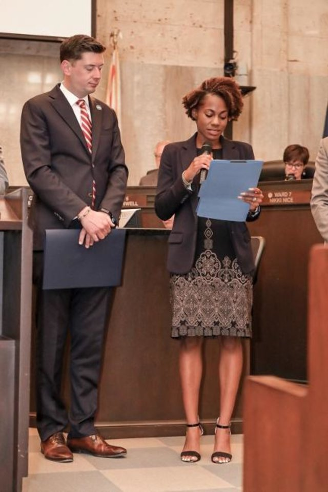 Photo -  Oklahoma City Mayor David Holt listens as Progress OKC Executive Director Maurianna Adams reads a proclamation for Minority Enterprise Development Week. [PROVIDED]