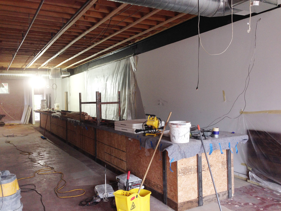 Photo -  The bar area inside Oak & Ore craft beer bar.    Nick Trougakos