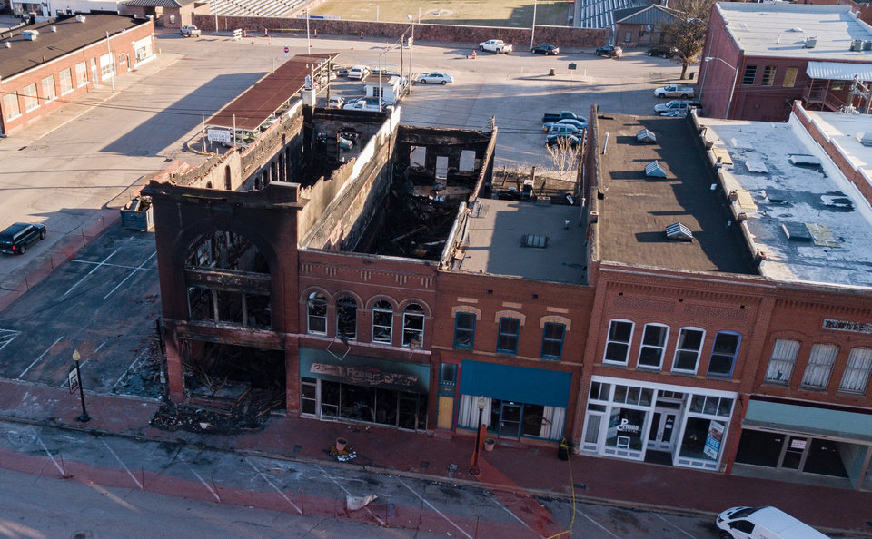 Photo - Drone image of fire damage at Double Stop Fiddle Shop and Furrows Flowers & Gifts in Guthrie. [David Morris/The Oklahoman]