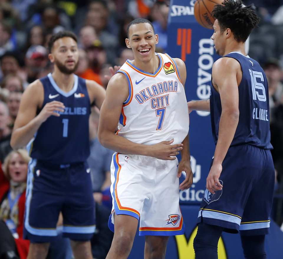 Photo - Oklahoma City's Darius Bazley (7) smiles after a dunk during an NBA basketball game between the Oklahoma City Thunder and the Memphis Grizzlies at Chesapeake Energy Arena in Oklahoma City, Wednesday, Dec. 18, 2019. Oklahoma City won 126-122. [Bryan Terry/The Oklahoman]