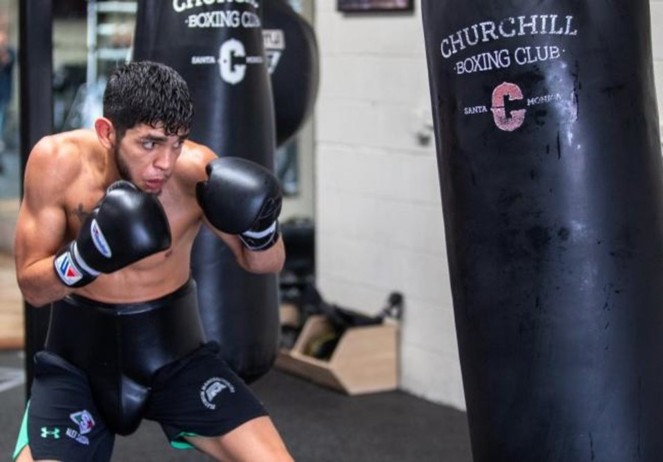 Photo -  Oklahoma City boxer Alex Saucedo will be back in the ring Tuesday night in Las Vegas. Before returning to California for training camp, he worked out during the coronavirus shutdown in a storage unit. [CHURCHILL BOXING]