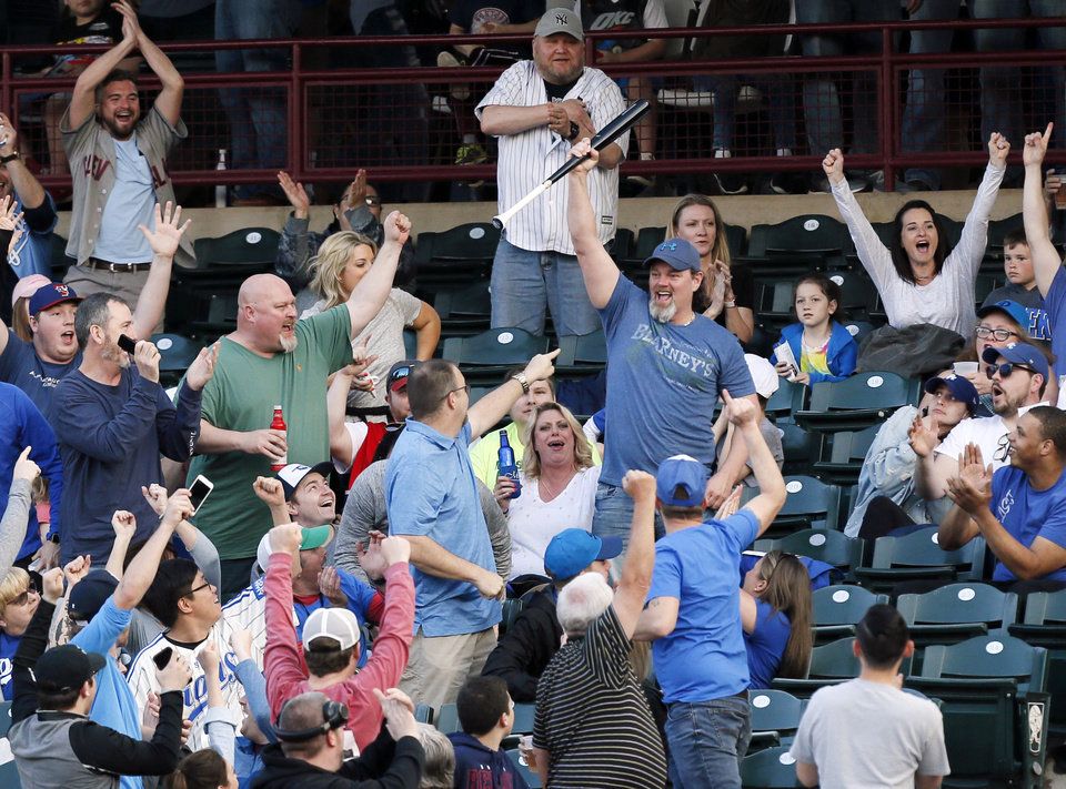 Photo - Fans cheer for a man who caught a bat in the bottom of the first inning during a minor league baseball game between the San Antonio Missions and the Oklahoma City Dodgers at the Chickasaw Bricktown Ballpark in Oklahoma City, Thursday, April 4, 2019. Photo by Nate Billings, The Oklahoman