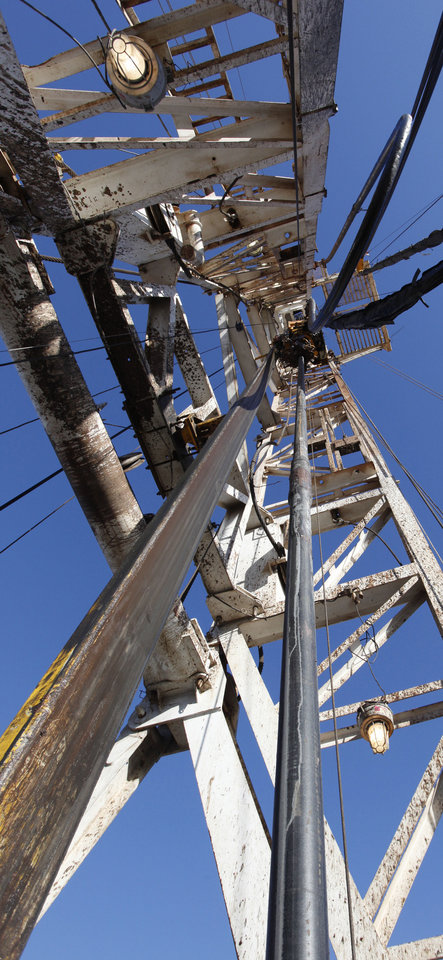 Photo -  The mast is shown on a rig drilling a well near Medford, in 2012. Futures prices for natural gas took a big tumble earlier this week, but forecasts show stored amounts of the fuel will less than the five-year average at the end of the market's traditional withdrawal season, an analyst says. [The Oklahoman Archives]