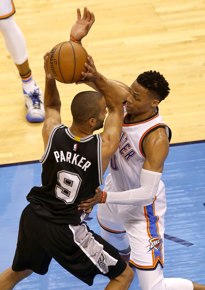 Photo - Oklahoma City's Russell Westbrook (0)  defends against San Antonio's Tony Parker (9) during Game 4 of the Western Conference semifinals between the Oklahoma City Thunder and the San Antonio Spurs in the NBA playoffs at Chesapeake Energy Arena in Oklahoma City, Sunday, May 8, 2016. Photo by Sarah Phipps, The Oklahoman