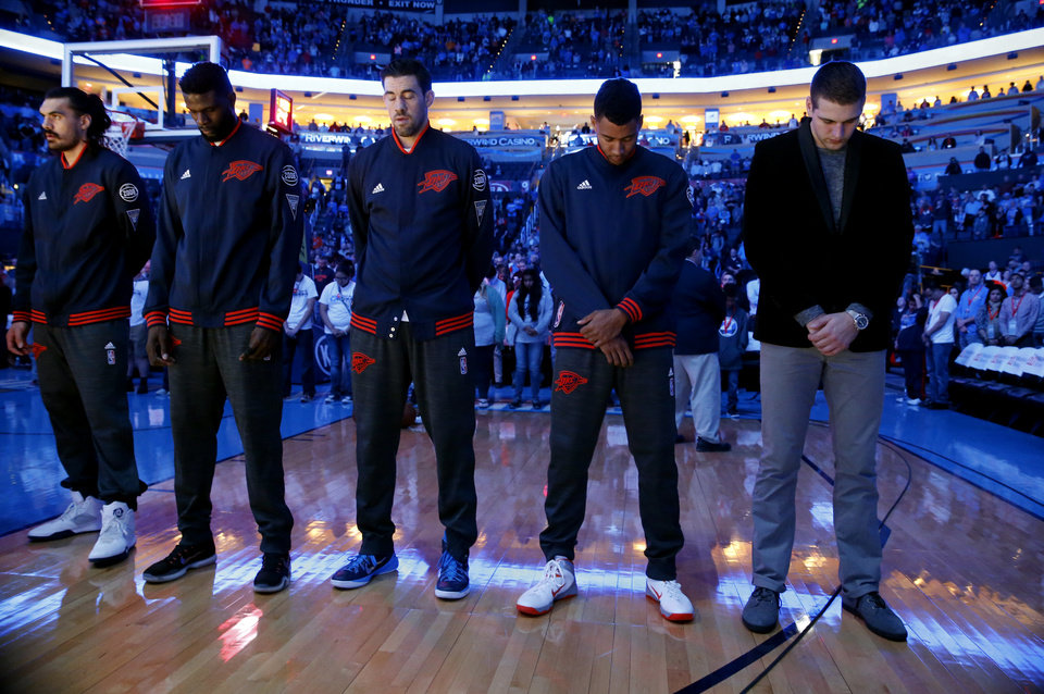 Photo -  Oklahoma City Thunder players bow their heads as Life.Church Moore worship pastor Scott Floyd leads in a prayer before an NBA basketball game between the Thunder play the Utah Jazz on March 24 at the Chesapeake Energy Arena in Oklahoma City. [Photo by Steve Sisney The Oklahoman]