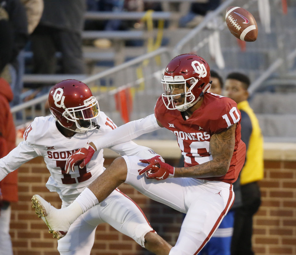 Photo - Oklahoma's Parnell Motley (11) breaks up a pass intended for Oklahoma's Theo Wease (10) during the University of Oklahoma's (OU) spring football game at Gaylord Family-Oklahoma Memorial Stadium in Norman, Okla., Friday, April 12, 2019. Photo by Bryan Terry, The Oklahoman