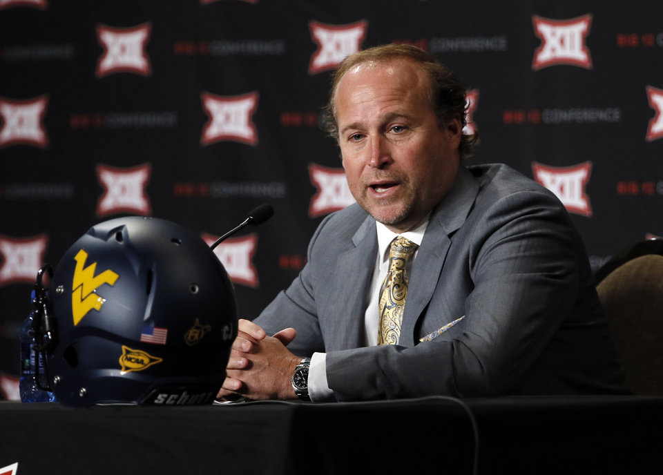 Photo - West Virginia head football coach Dana Holgorsen addresses attendees at the NCAA college Big 12 Conference Football Media Days Monday, July 20, 2015, in Dallas. (AP Photo/Tony Gutierrez)