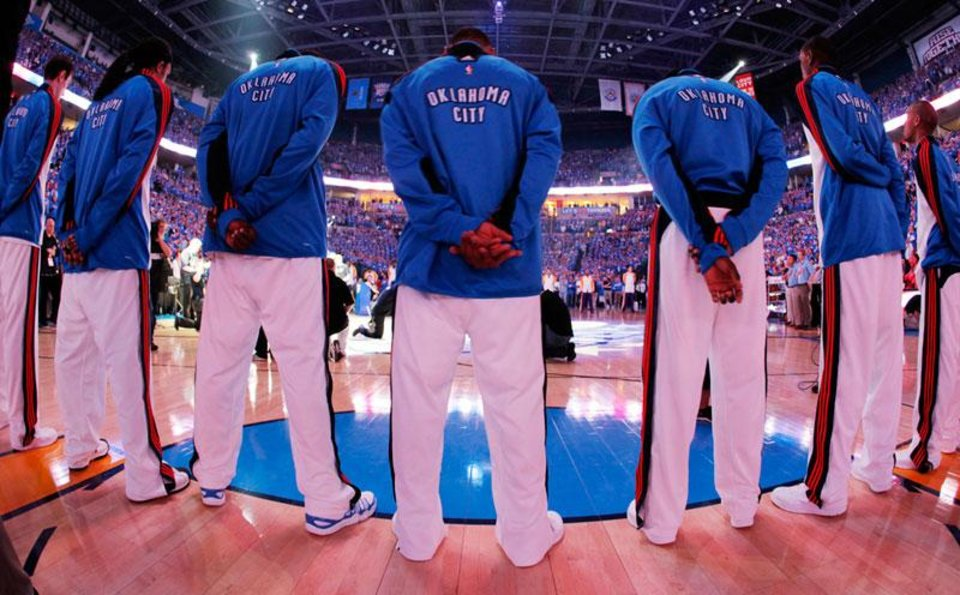 Photo -  The Oklahoma City Thunder stand for the National Anthem before the basketball game between the Los Angeles Lakers and the Oklahoma City Thunder in the first round of the NBA playoffs at the Ford Center in Oklahoma City, Thursday, April 22, 2010. Photo by Nate Billings, The Oklahoman
