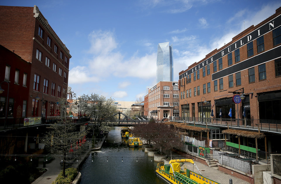 Photo - Bricktown is pictured in Oklahoma City, Wednesday, March 18, 2020. [Sarah Phipps/The Oklahoman]