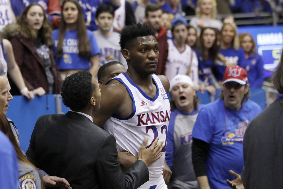Photo - Kansas forward Silvio De Sousa (22) walks out of the crowd after a brawl during the second half of an NCAA college basketball game against Kansas State in Lawrence, Kan., Tuesday, Jan. 21, 2020. Kansas defeated Kansas State 81-59. (AP Photo/Orlin Wagner)