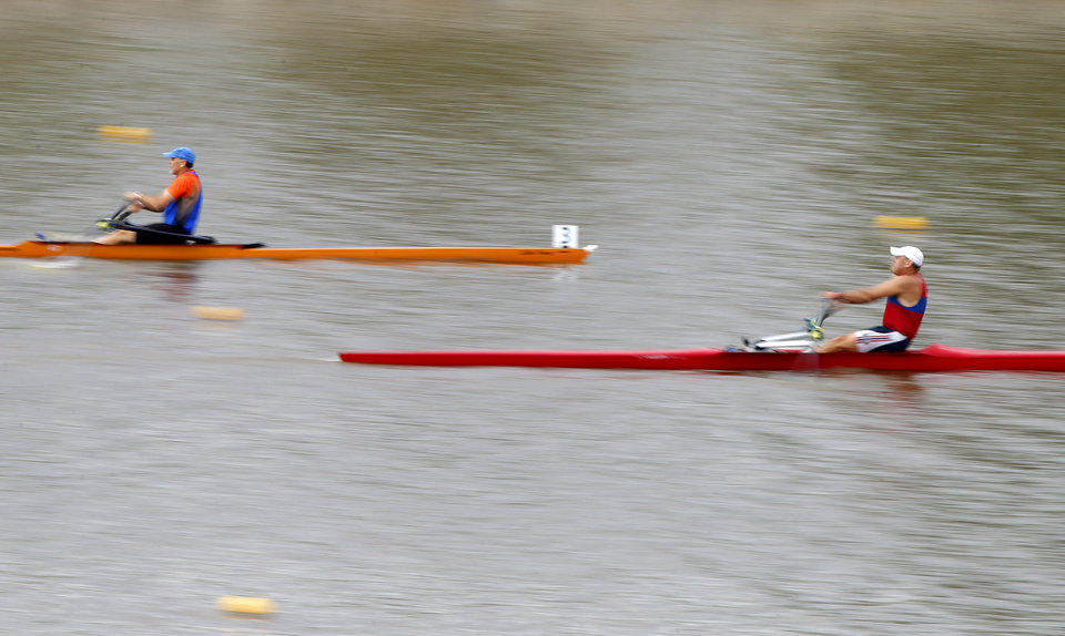 Photo - Racers row down the Oklahoma River during the Stars & Stripes River Festival in Oklahoma City, Saturday, June 24, 2017. Photo by Bryan Terry, The Oklahoman