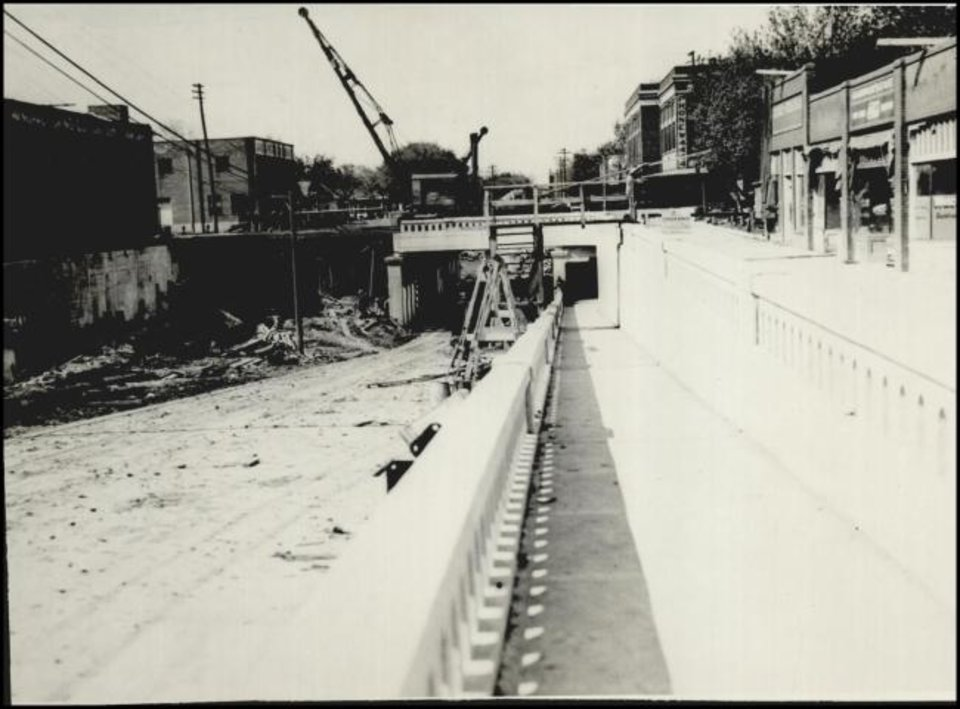 Photo -  Contractors build an underpass to get Walker Avenue under the tracks built to handle Rock Island and Frisco trains after voters approved a bond issue to relocate the tracks out of the central business district. [THE OKLAHOMAN ARCHIVES]