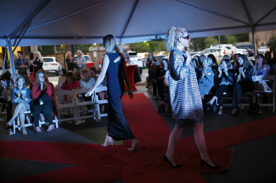 Photo -  New fall trends are displayed on the runway during Chi Omega's Fashion with a Passion at CK & Co. in Nichols Hills Plaza. [PHOTO BY SARAH PHIPPS, THE OKLAHOMAN]