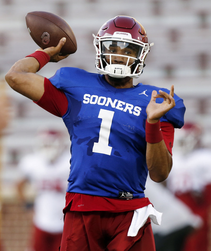 Photo - OU quarterback Jalen Hurts passes the ball during football practice for the University of Oklahoma Sooners at Gaylord Family - Oklahoma Memorial Stadium in Norman, Okla., Monday, Aug. 12, 2019. [Nate Billings/The Oklahoman]