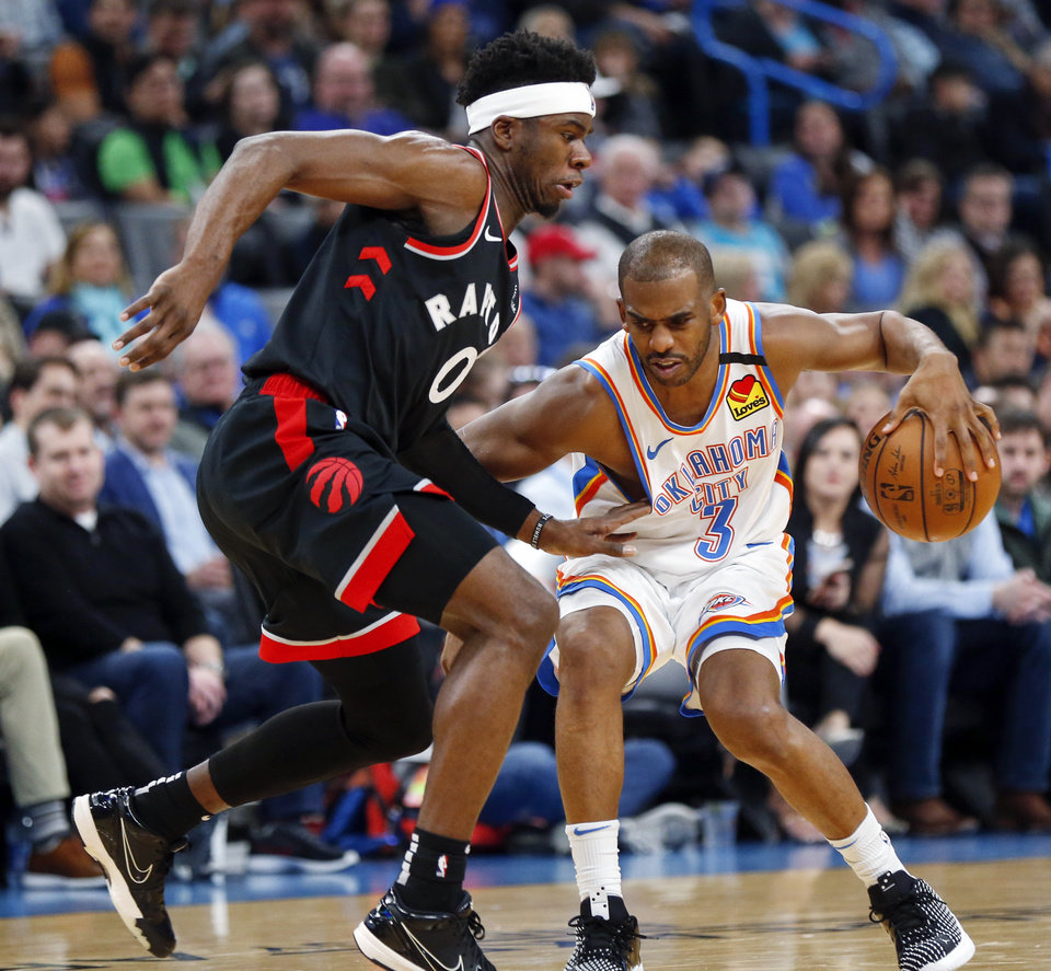 Photo - Oklahoma City's Chris Paul (3) dribbles as Toronto's Terence Davis II (0) defends during an NBA basketball between the Oklahoma City Thunder and the Toronto Raptors at Chesapeake Energy Arena in Oklahoma City, Wednesday, Jan. 15, 2020. [Nate Billings/The Oklahoman]