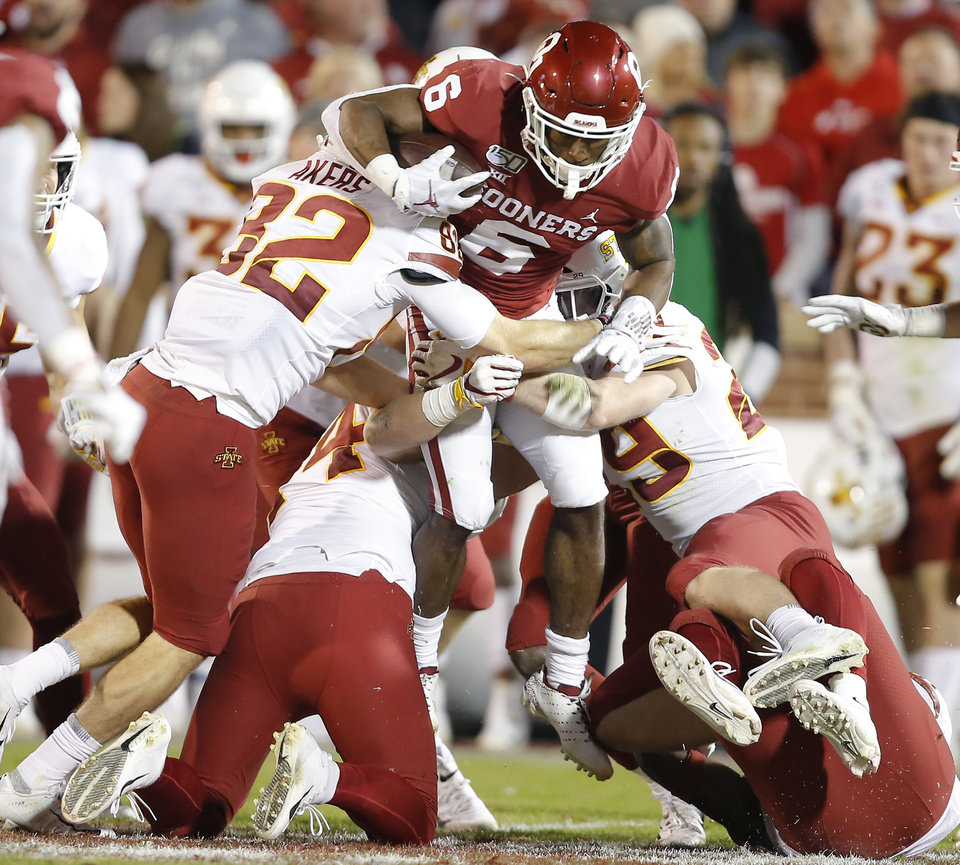 Photo - Oklahoma's Tre Brown (6) is brought down while returning a kickoff during an NCAA football game between the University of Oklahoma Sooners (OU) and the Iowa State University Cyclones at Gaylord Family-Oklahoma Memorial Stadium in Norman, Okla., Saturday, Nov. 9, 2019. [Bryan Terry/The Oklahoman]