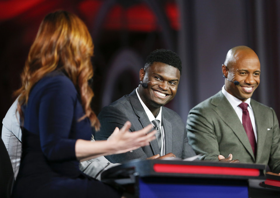Photo - Duke's Zion Williamson, second from right, is interviewed by an ESPN reporter during the NBA basketball draft lottery Tuesday, May 14, 2019, in Chicago. (AP Photo/Nuccio DiNuzzo)