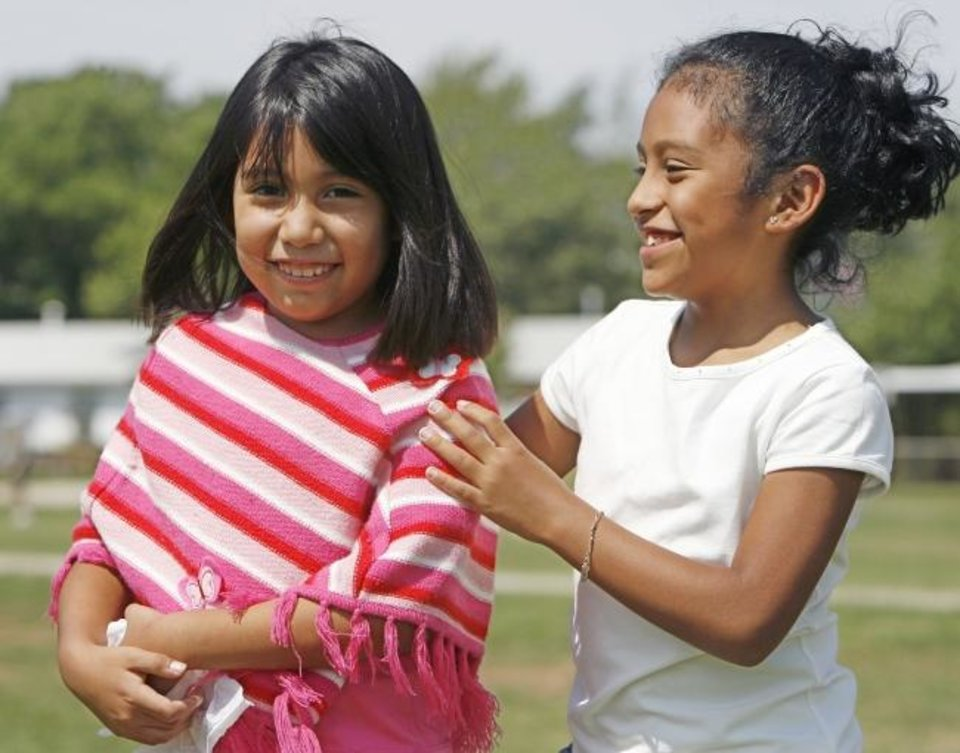 Photo -  Rosalinda Espinosa is shown in 2006 playing with Jasmine Garcia on the playground at Hillcrest Elementary School where they were both third graders. [Oklahoman Archives]